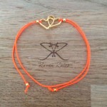 Raven Rules Gold Hearts Neon Orange